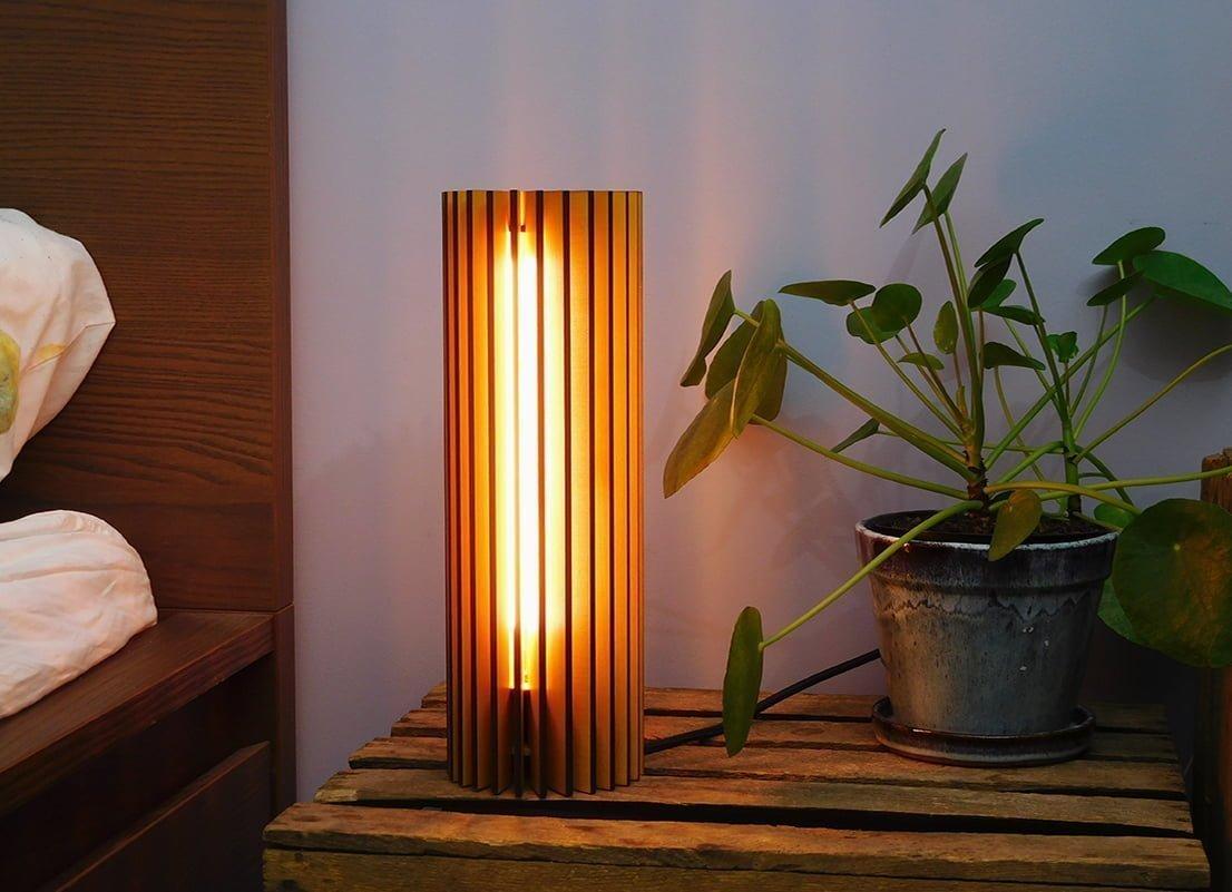Knop die je leid naar de productpagina van de Nr.1 Lamp. Lasergesneden houten designlampen en meubels